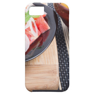 Black plate with fresh salad of tomatoes, onions iPhone SE/5/5s case