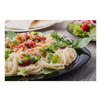 Black plate with spaghetti and chicken poster