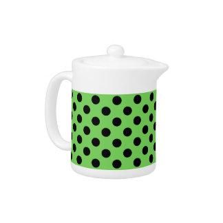 Black polka dots on lime green teapot