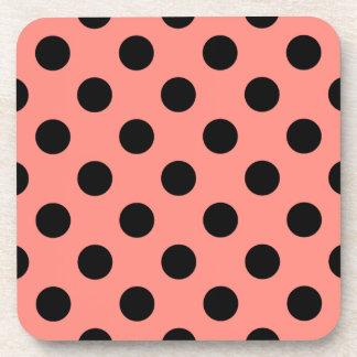 Black polka dots on peach coaster