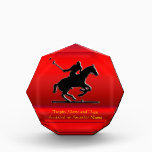 """Black Polo Pony and Rider on red chrome-look Acrylic Award<br><div class=""""desc"""">Sports series A great design for a Polo Award. It features an embossed-look black galloping polo pony with rider about to strike the ball with the mallet. On a brushed metal-effect red background, change the golden place-holder text as desired to suit your award title, the year / date and the...</div>"""