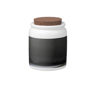 Black professional blood pressure monitor on white candy jar