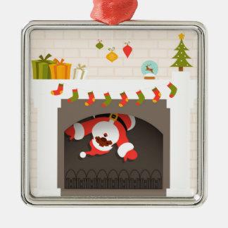 black santa stuck in fireplace metal ornament