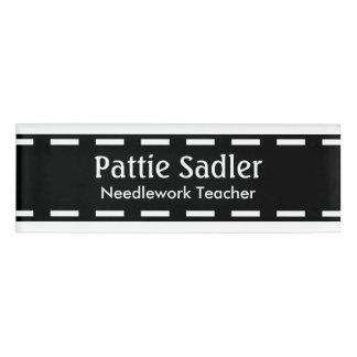 Black seam border + your ideas name tag