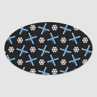 Black skis and snowflakes pattern oval sticker