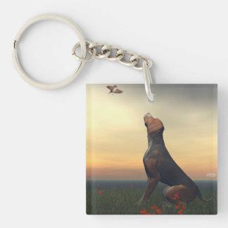 Black tan dog looking a bird flying keychain