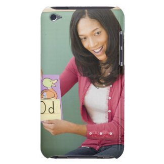 Black teacher showing letter d flash card to iPod touch covers