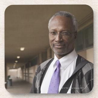 Black teacher standing in school corridor coaster