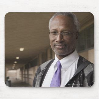 Black teacher standing in school corridor mouse pad