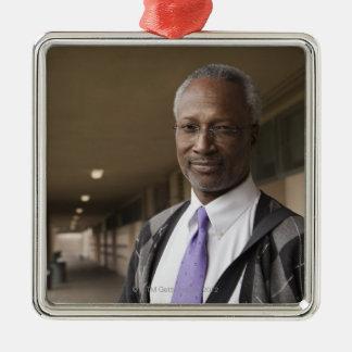 Black teacher standing in school corridor ornaments