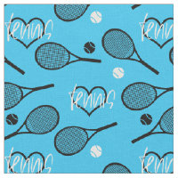 Black tennis rackets on blue fabric