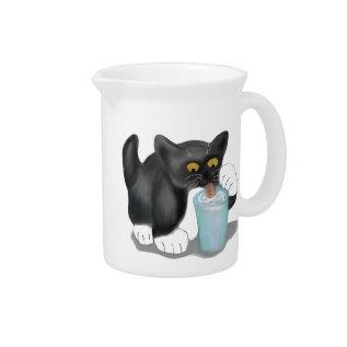 Black Tuxedo Kitten Sneaks A Glass Of Milk Pitcher at Zazzle