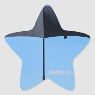 Black umbrella flies in blue sky star sticker