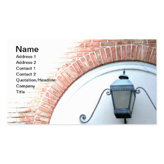 black wall lantern on outside of brick building business cards