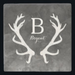 "Black Watercolor and Rustic Deer Antlers Monogram Stone Coaster<br><div class=""desc"">A black and white watercolor background with subtle splashes and paintbrush strokes lays the foundation for a beautiful, trendy item. Personalize it with your name and monogram! A pair of rustic white european deer antlers adds a touch of country. Fits neutral decor and makes an artistic gift for those who...</div>"