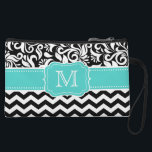 "Black White Chevron Floral Damask Mint Monogram Wristlet<br><div class=""desc"">Decorate your bag in style with this Monogram Black White Chevron Floral Damask design. Custom Wristlet Clutch is a great every day bag to take you through your day! You can personalize your wristlet by adding your initials or customize it with a message to give as a gift for a...</div>"