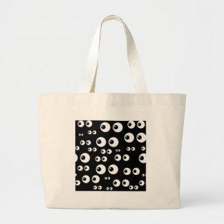 black white eyes large tote bag