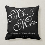 "Black &amp; White Mr. and Mrs. Wedding Pillow<br><div class=""desc"">Personalized Black and White Mr. and Mrs. Wedding Pillow. Design by Elke Clarke&#169;. Available at www.zazzle.com/monogramgallery. Classy, personalized, custom solid color black background, customizable with bride and groom names in white script font and wedding date. Beautiful design is perfect for wedding gifts, sweetheart pillows, wedding anniversary gifts and more. Use...</div>"