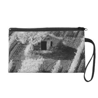 Black White view of small stone barn Wristlet