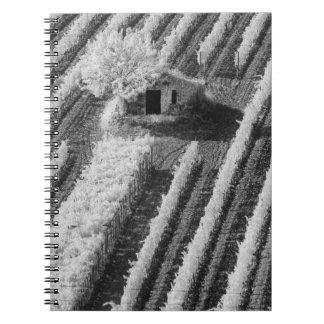 Black & White view of small stone barn Notebook