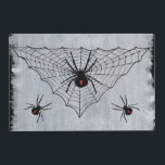 """Black Widow Spider Web Halloween Gothic Placemat<br><div class=""""desc"""">A black widow spider is sitting in her triangular spider web waiting for the next prey,  surrounded by additional spiders. She has the famous red hour glass mark of a black widow. Image is my original painting. See my store Art by MAR for matching products with this design.</div>"""