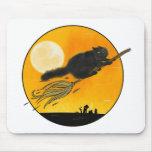 Black witch cat on broom mauspads