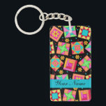 "Black with Colorful Quilt Blocks &amp; Personalized Keychain<br><div class=""desc"">Original quilt art combines favorite quilt blocks plus unique blocks to form a quilt design with vibrant and dynamic colors on a black background. Your keychain can be personalized with your name, business name or other words of your choice on a turquoise strip. If you don&#39;t want to personalize, you...</div>"