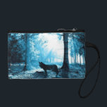 "Black Wolf Alone in the Forest Change Purse<br><div class=""desc"">Black wolf standing alone in the shadows of a dark forest. The nature scene is backlit with a bright sun beaming icy blue lighting through the trees.</div>"