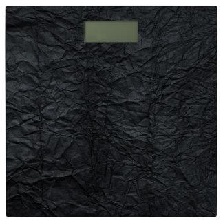black wrinkled paper bathroom scale