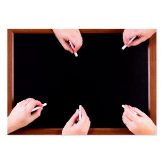 Blackboard with many hands with chalk business cards