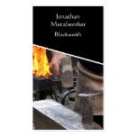Blacksmith hammering hot iron business card