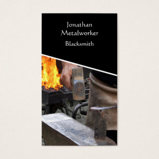 Blacksmith hammering hot iron business card