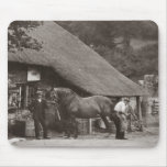 Blacksmith shoeing a horse mouse pad