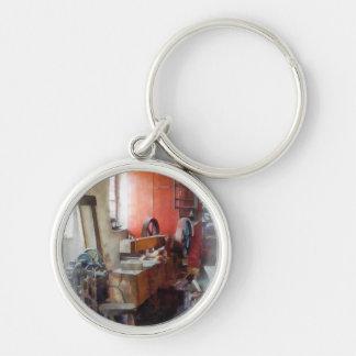 Blacksmith Shop Near Window Silver-Colored Round Keychain
