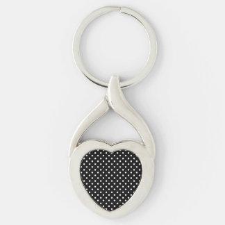 Blanco en diseño negro del punto llavero plateado en forma de corazón