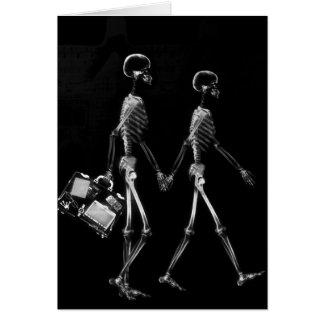 Blanco negro que viaja de los pares esqueléticos d felicitación