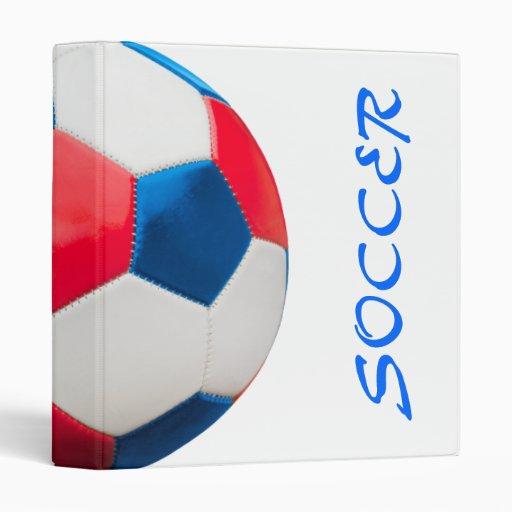 Blanco rojo y azul de la carpeta del fútbol en bla