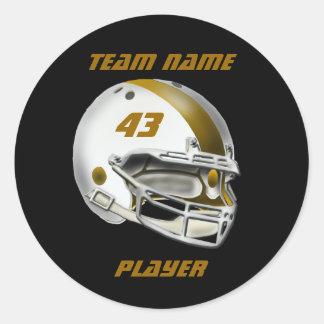 Blanco y casco de fútbol americano del oro pegatina redonda