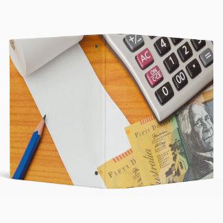 Blank list with Australian dollars and calculator Binder