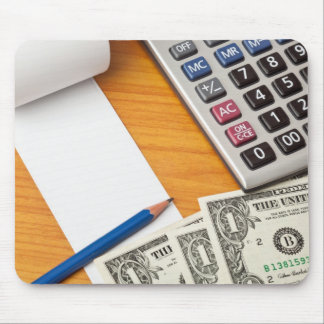 Blank list with dollar bills and calculator mouse pad