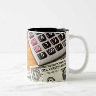 Blank list with dollar bills and calculator Two-Tone coffee mug