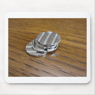Blank metallic coins on wooden table mouse pad