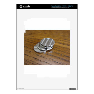 Blank metallic coins on wooden table skin for iPad 3