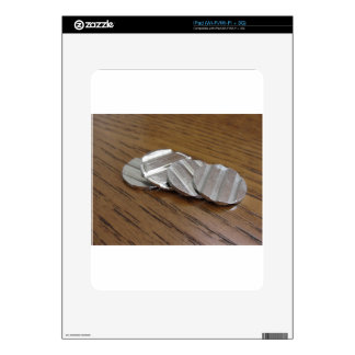 Blank metallic coins on wooden table skins for the iPad