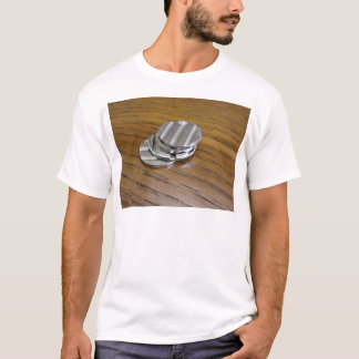 Blank metallic coins on wooden table T-Shirt