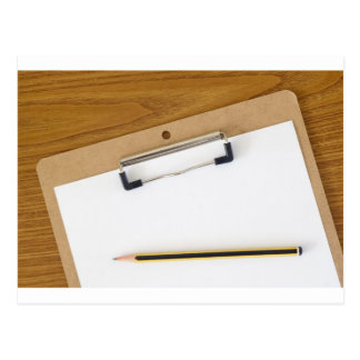 Blank paper on a clipboard post card