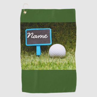 Blank sign for your name with golf ball on grass golf towel