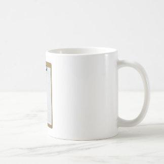 Blank writing paper on clipboard coffee mug