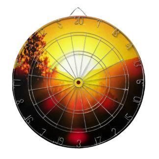 Blazing sunset. dartboard with darts