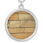 block wall overlay orangy color custom necklace